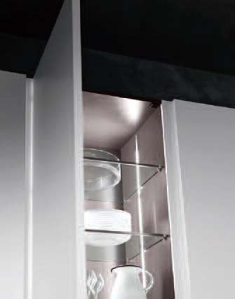 When they are opened, the led lights recessed in the side panel turn on. The fridge and oven tall units face each other creating an easy-to-use work corner.