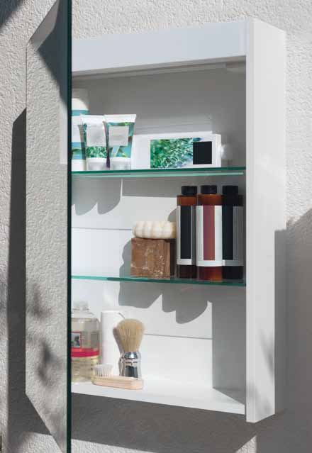 The integrated lighting provides a cosy ambient light through a cut-out in the mirror. The cabinets can be optionally fitted with switches and sockets.