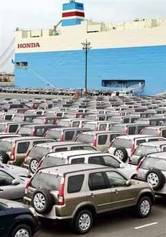 File photo shows Japanesemade vehicles being prepared for shipment at Narashino port in Chiba
