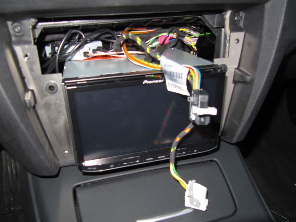 4. finally place-in the double-din device, take