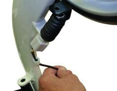 Remove the screw holding the brake handle onto the handle bar using a Phillips screw driver. Remove the brake handle.