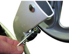 Push any excess brake cable in to the hole in the lower frame.