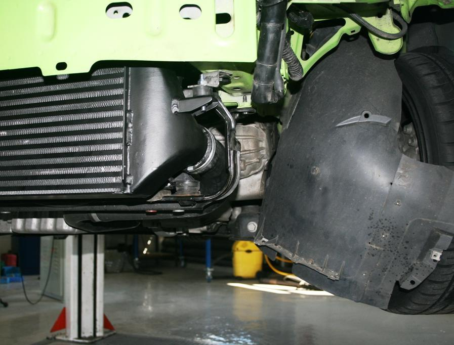 / Position the intercooler in place over the original mounting points left and right, images (1.